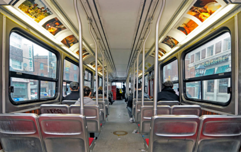 Toronto (TTC) bus. Photo Credit:  https://www.blogto.com/arts/2010/05/what_happens_when_a_streetcar_becomes_an_art_gallery/