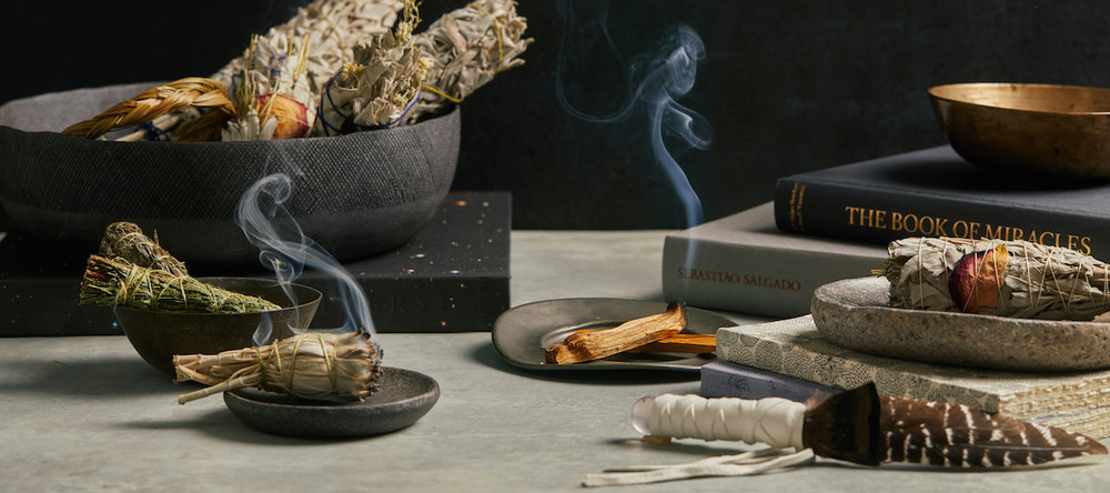Burning white dried sage (left) and palo santo (right).