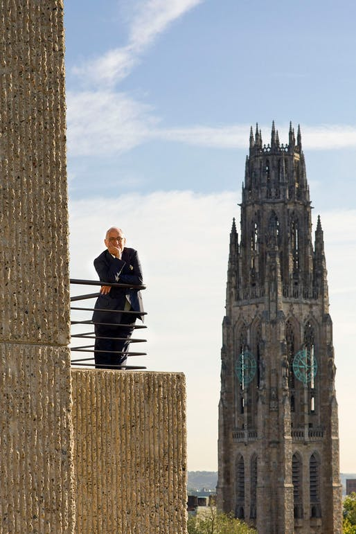 Robert A. M. Stern, former Dean of Yale's school of architecture. He is shown standing on a portion of Rudolph's  Yale Art & Architecture  building. Yale's  Harkness Tower  is in the background. Photo: Peter Aaron/OTTO