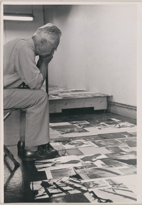 Edwin Steichen, the Director of the Museum of Modern Art's Department of Photography, facing the task of selecting & organizing photographs for the exhibit. Photo: MoMA