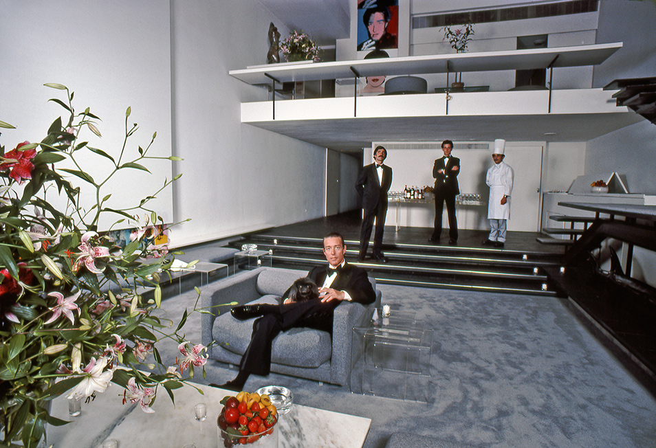 "The great fashion designer Halston, enthroned in his living room—within the famous ""101"", the townhouse in New York's Upper East Side neighborhood in Manhattan    Photo by Harry Benson, from a feature on Halston in Life Magazine"