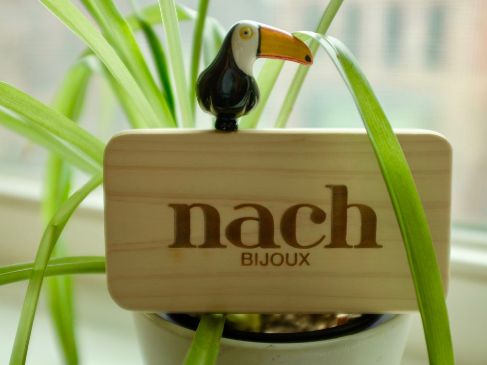 Nach Bijoux - Nadia & Nancy Koch, two sisters at the heart of the french brand: Nach. Based in their hometown, Toulouse (South of France), Nach is born from a common passion for fashion and a family legacy: their father worked in porcelain miniatures for more than 40 years. With this know-how, turning porcelain into trendy, high-end jewelry was the sisters' vision. All Nach pieces are entirely handmade and meticulously hand-painted, signed and, therefore, unique.