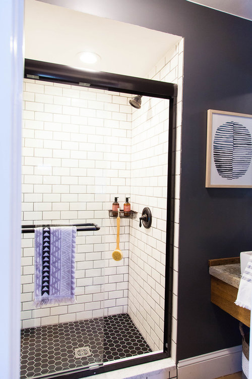 New bathroom shower with subway tile and glass door