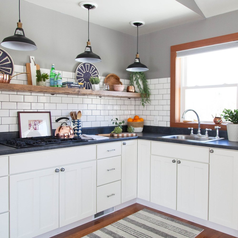 Guest house or bridal suite kitchen with white cabinets and subway tile