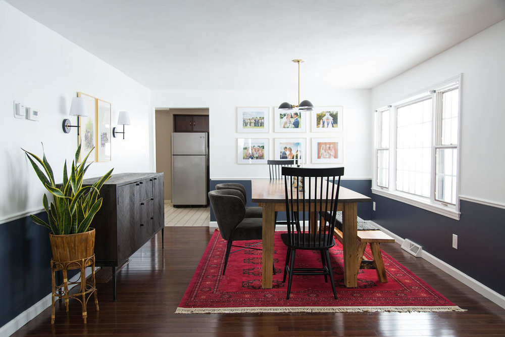 Dining room with custom dining table, gallery wall, red rug
