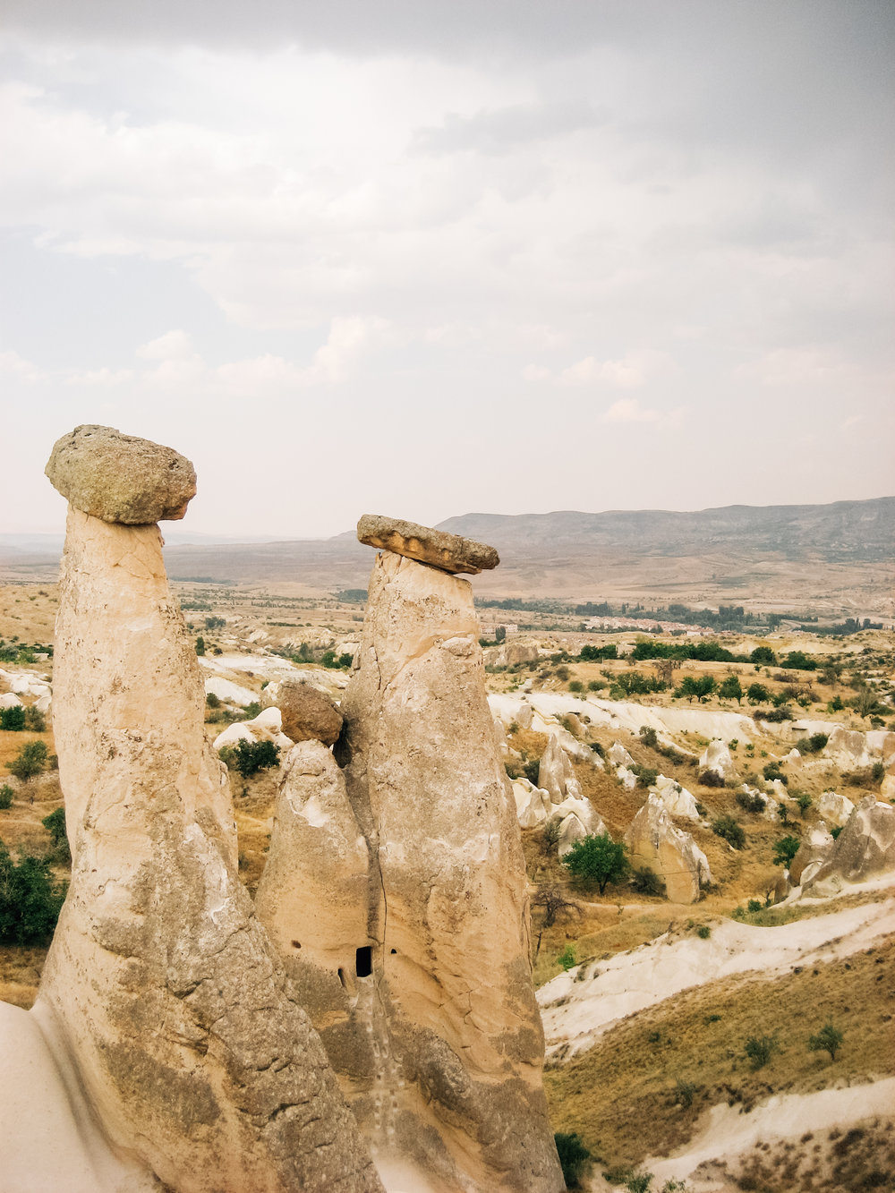 The rocks of Cappadocia twist and turn from the ground in thick stalks -