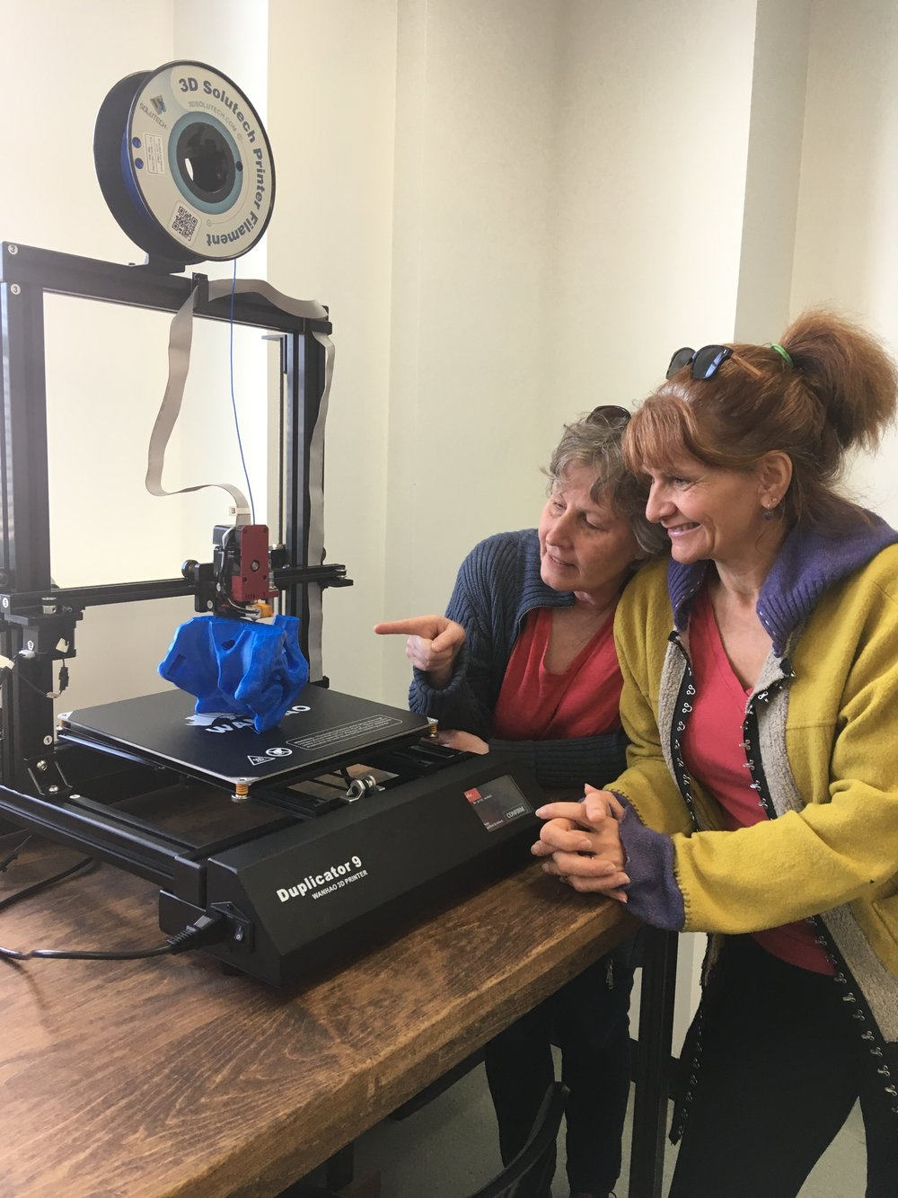 Rena and Peggy check out a large scale 3D printer at Maker North.