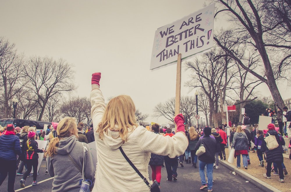 """""""A group of people protesting and demonstrating in Washington"""" by  Jerry Kiesewetter  on  Unsplash"""