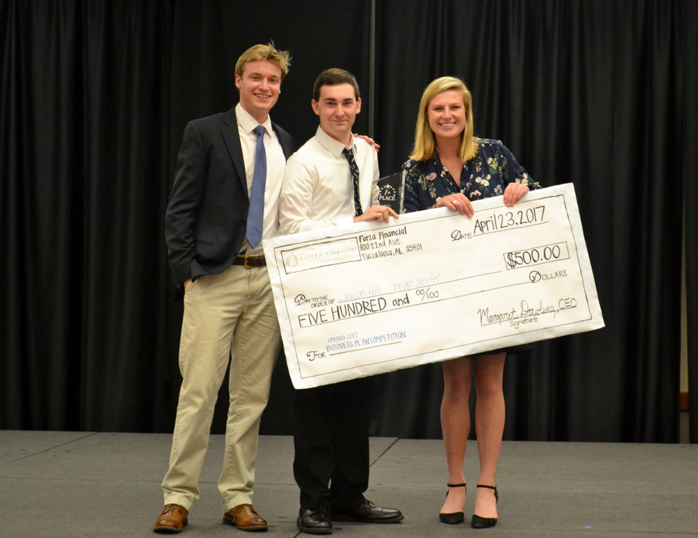 Lawson Hill, the 2017 Forza Financial Business Plan Competition winner, stands with then CMO Jon Hanley and CIO Fig Stallings.