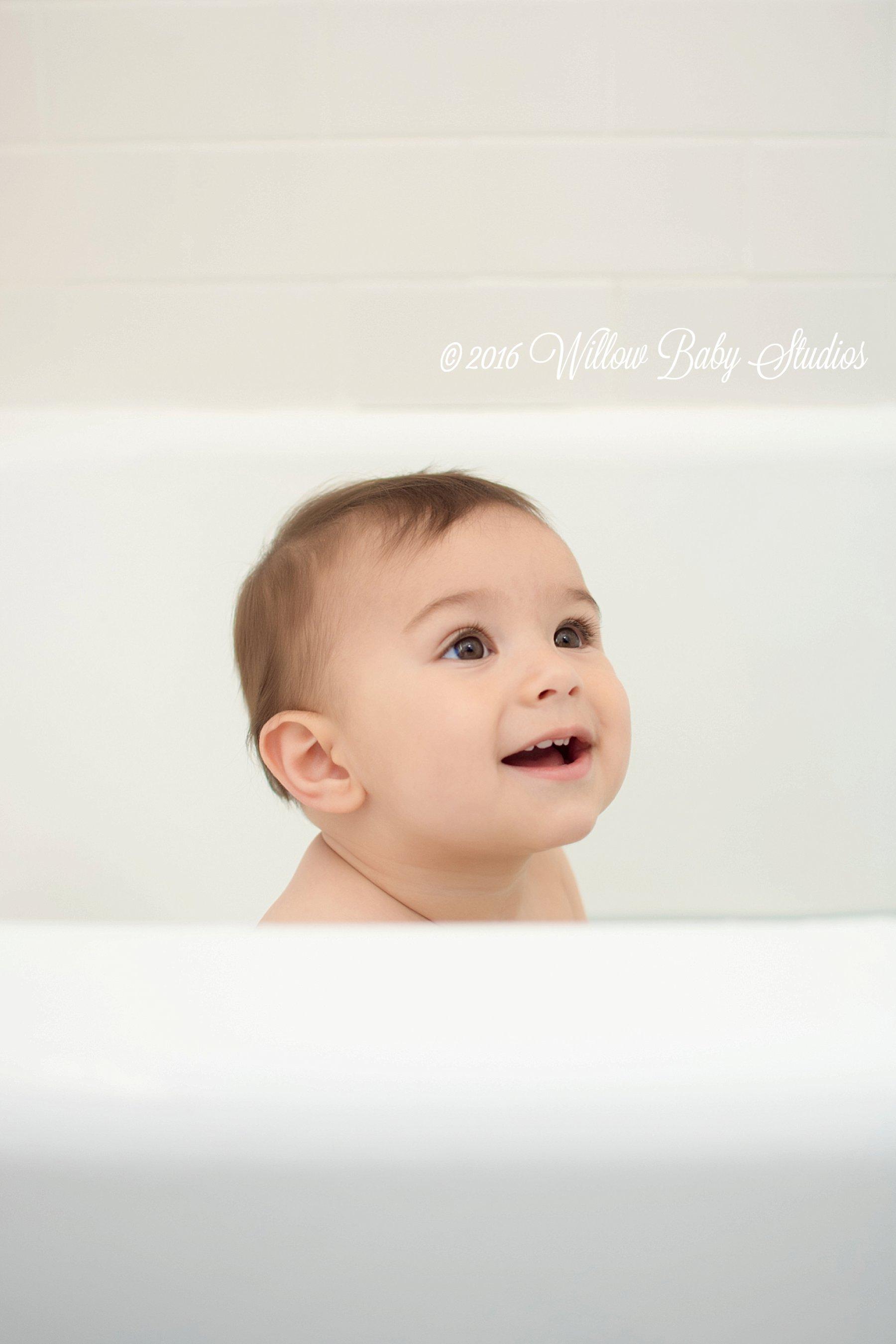 cute baby smiling in bathtub