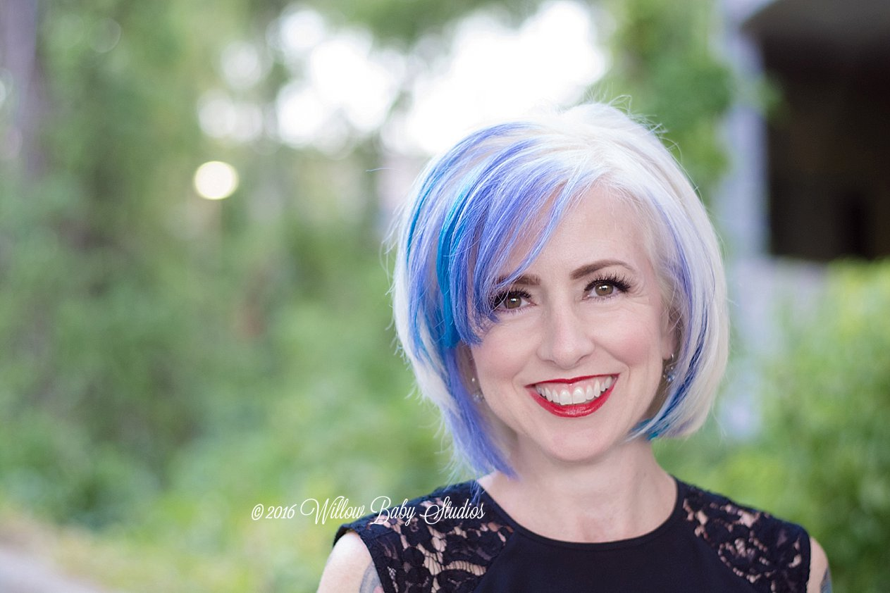 headshot-blond-hairstylist-with-blue-purple-coloring