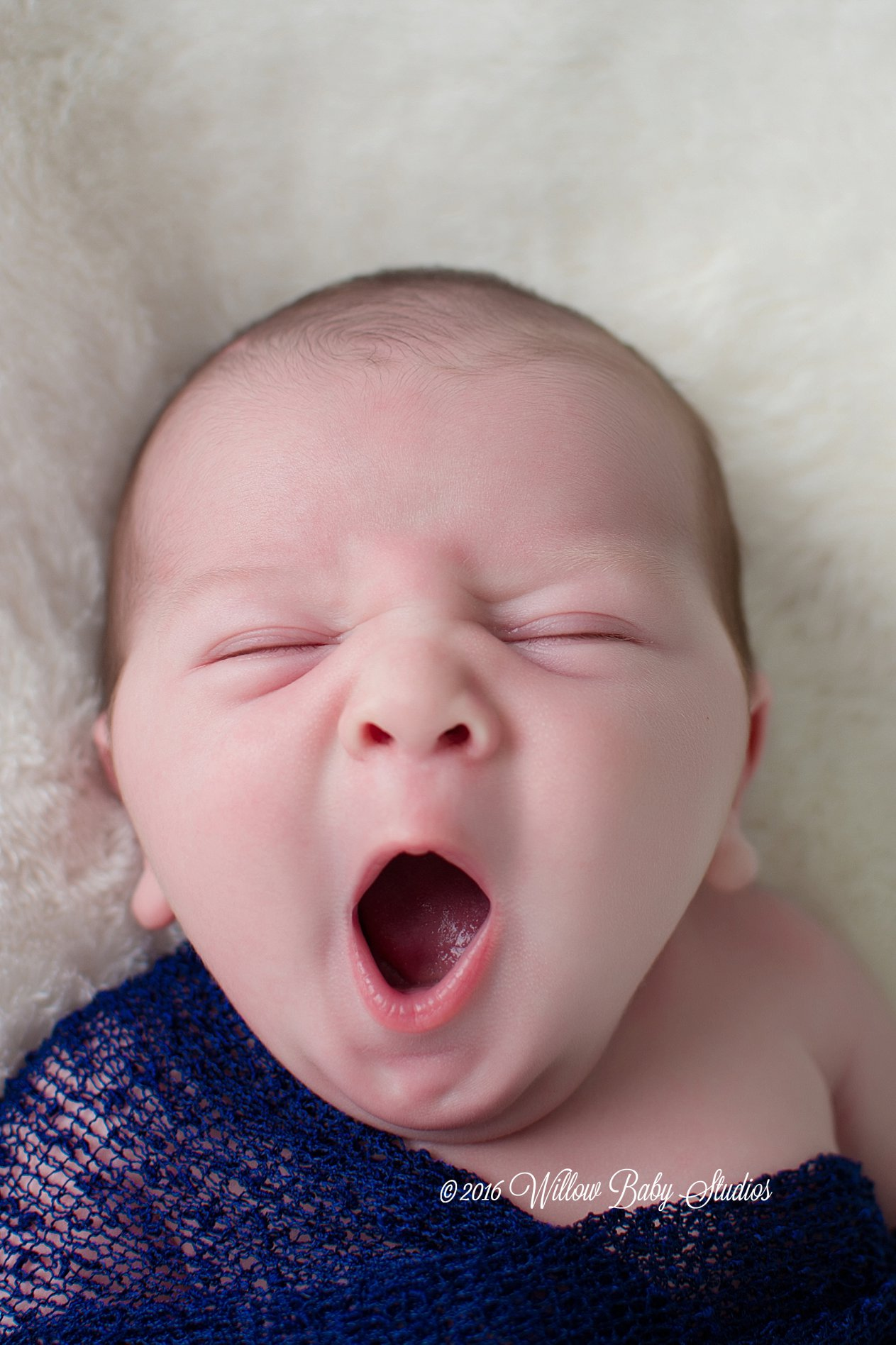 newborn yawning wide
