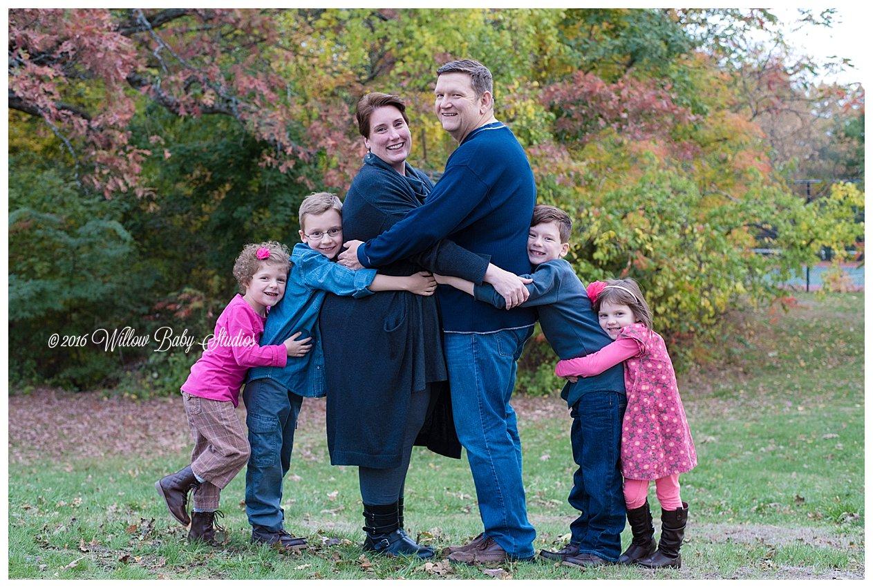 family of six giving giant hugs