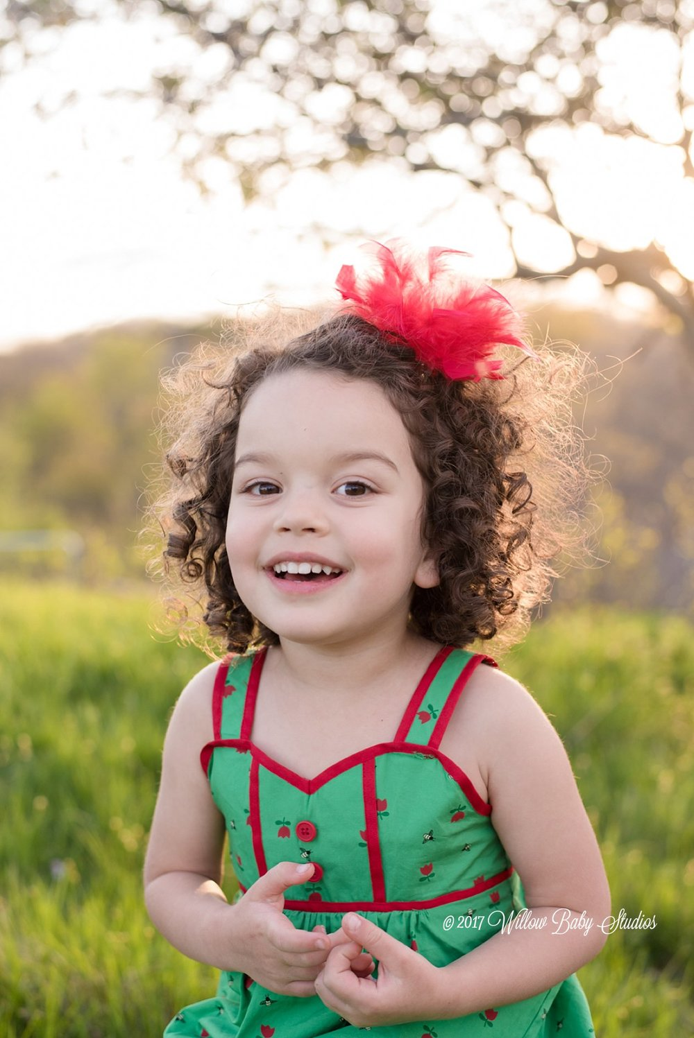 curly-haired-smiling-girl-spring-evening