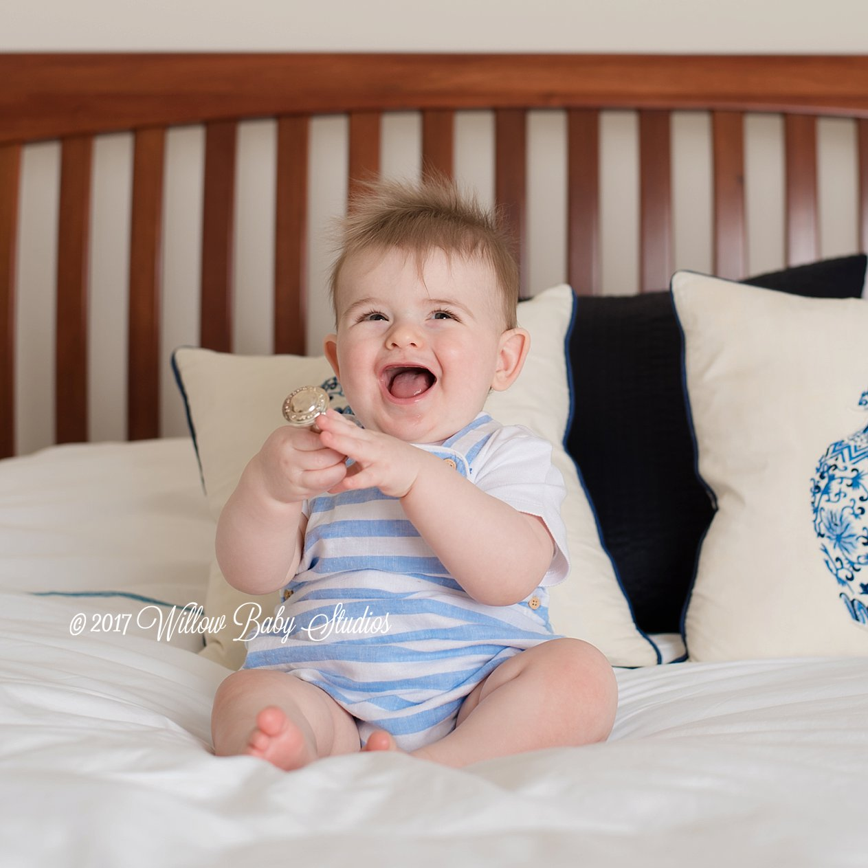 super smiley baby playing with classic rattle