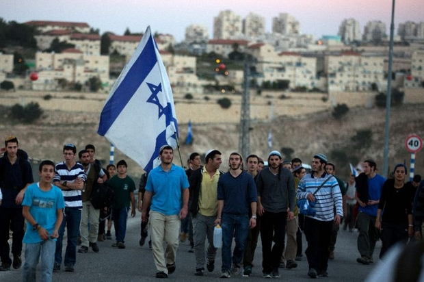 Israelis march from the illegal settlement of Maale Adumim to the E1 zone in February 2014 (AFP)