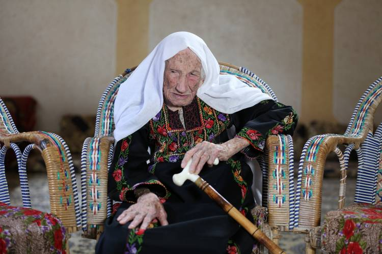 105-year-old Hakma Atallah, a Nakba survivor and Palestine refugee living in Beach Camp, west of Gaza City, fled from her original village Al-Swafeer in 1948 when she was 35 years old. © 2018 UNRWA PHOTO BY MOHAMMED HINNAWI.