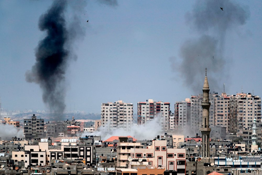Smoke billowing in the background following an Israeli air strikeת Gaza City, May 29,