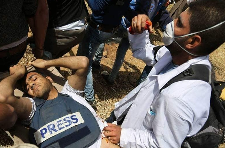 30-year-old Yaser Murtaja was shot despite wearing a vest that clearly identified him as a journalist. This amounts to a  war crime .