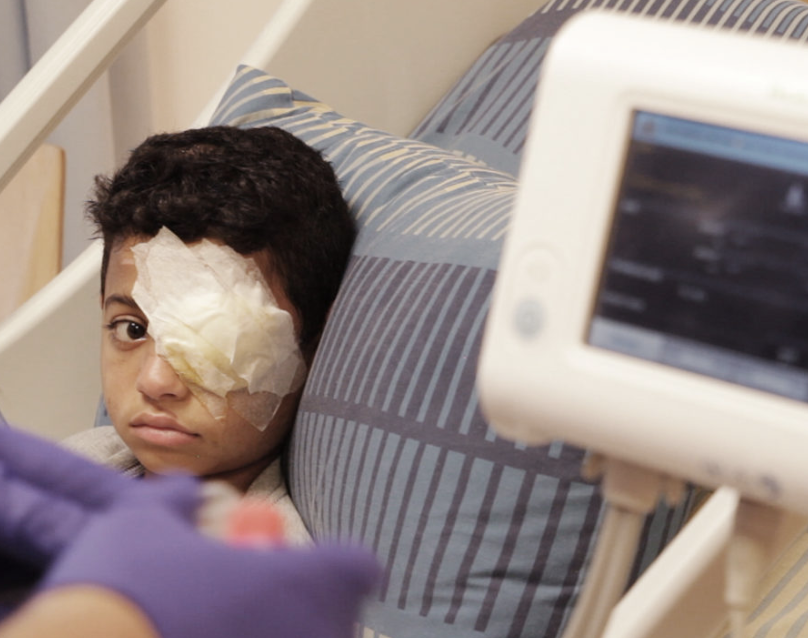Mahmoud in his hospital bed in Ramallah in the week before his operation.