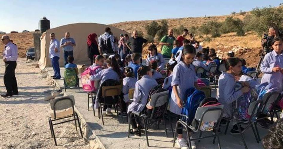 Jub al-Dhib School in Bethlehem met outdoors, August 2017, after the Israeli occupation forces turned their classrooms into mounds of rubble. Soldiers seized makeshift classrooms under the pretext that they are installed in a closed military zone. Palestinian locals who came to protest were met with beatings, rubber bullets, and live rounds.