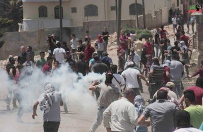 A protest in Kufur Qaddoum, as Israeli soldiers attack.
