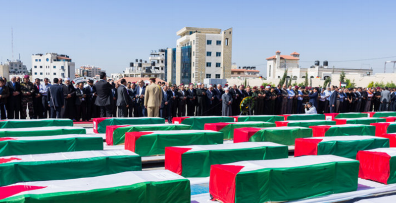 Official ceremony in Ramallah for the remains of Palestinians given back by Israel, May 2012. Photo by Lazar Simeonov.