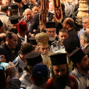 Greek Orthodox Patriarch of Jerusalem Theophilos III leads the Orthodox Easter ceremony of the 'Holy Fire' in the Church of the Holy Sepulchre in Jerusalem's Old City on April 15, 2017. (AFP/Gali Tibbon)