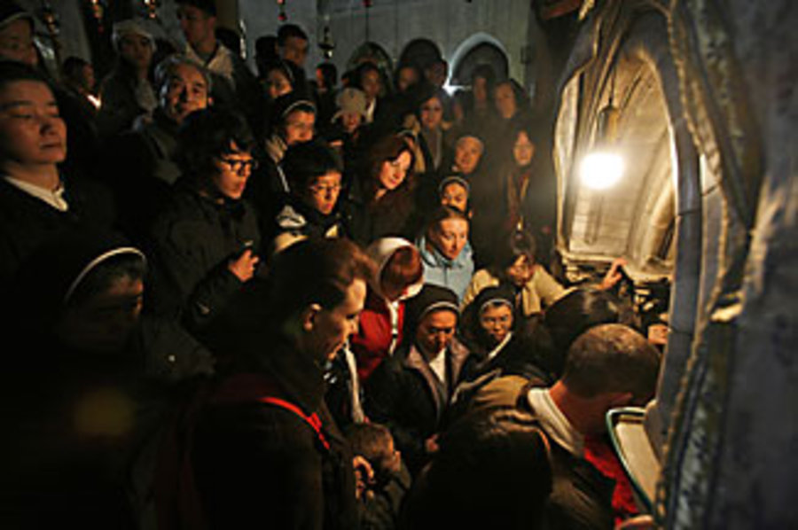 Tourists in the West Bank city of Bethlehem, waiting to enter the grotto inside the Church of the Nativity, believed to be the birthplace of Jesus