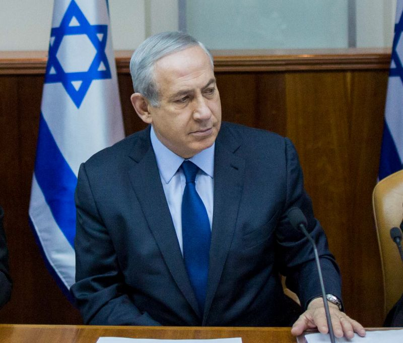 Israeli Prime Minister Benjamin Netanyahu (L) at weekly government cabinet meeting
