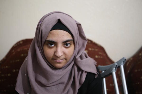 Ahlam Abu Musa, 20, was diagnosed with cancer in May 2018. The treatment she needs is not available in the strip, but the Israeli army has denied her multiple requests to exit through the Erez Crossing. (Photo by Amjad Yaghi)