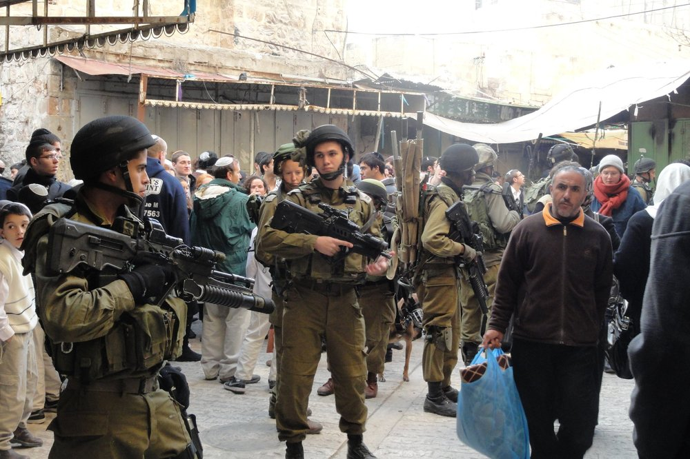 Each week, settler-organized tour groups walk through the old city of Hebron, accompanied by a large number of fully armed Israeli military soldiers who clear the path for the settlers and tourists and stop all movement in the old city. This is standard procedure as all Israeli citizens have the right to protection by the Israeli military.