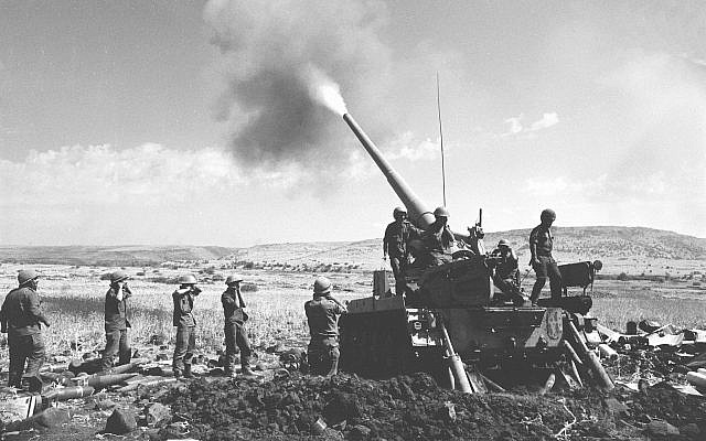Israeli troops fire a cannon from a position on the Golan Heights during the Yom Kippur War on October 11, 1973. (Radovan Zeev/Bamahane/Defense Ministry Archives) [photo:  Times of Israel ]