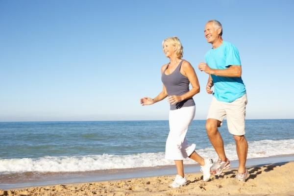 mature-couple-running-on-beach.jpg