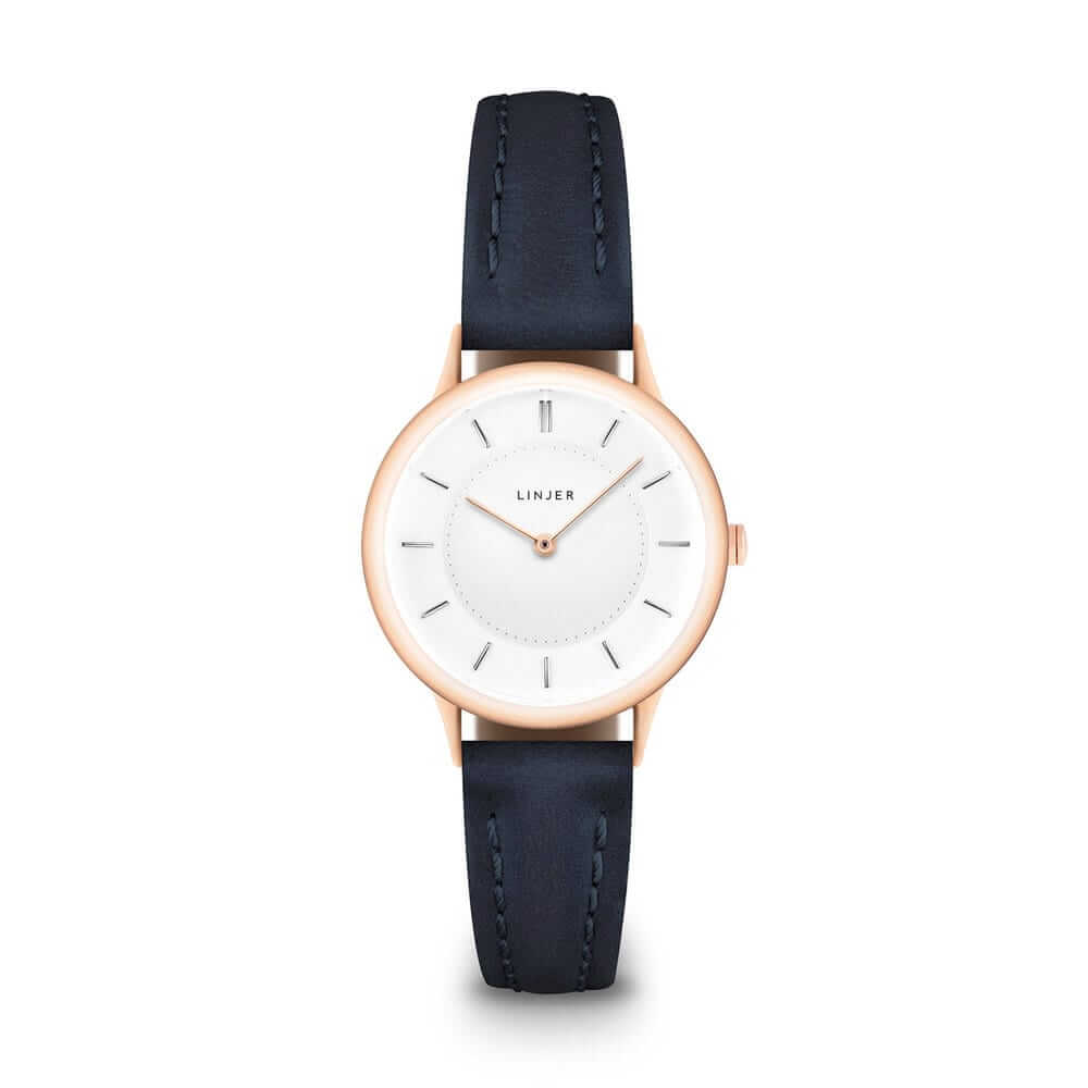 The Petite Watch, Rose Gold/Navy, $249 - True to its name, The Petite has a small face (30mm), and its profile is elegantly tapered to make the case look even slimmer than it is. If you want a classy (and expensive-looking) watch without the usual bling-bling, this one's for you.
