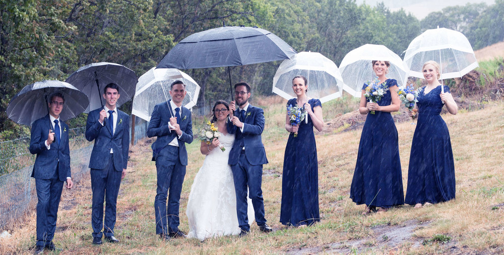 The brave wedding party in the summer rain. Photo credit -  Emily Frier