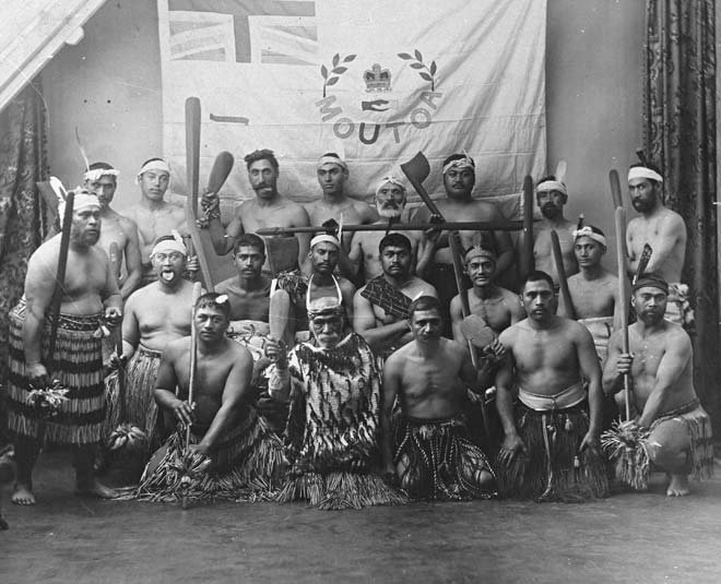 Loyal Wanganui Maori with the flag presented to them after their victory against rebels at Moutoa Island