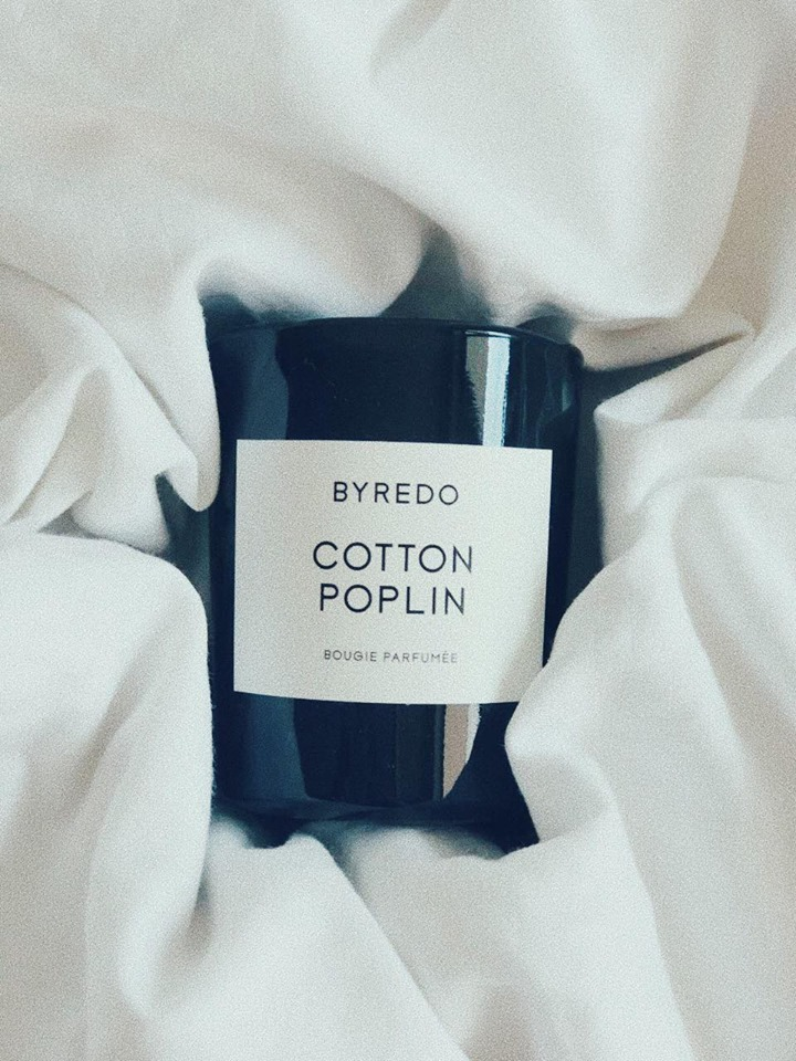 WE ARE NOT EXAGGERATING WHEN WE SAY WE 'VE BEEN OBSESSED WITH BYREDO FOR LIKE EVER. FROM PERFUMES TO HAND CREMES TO HAIR PERFUME OR YES, CANDLES – BEN GORHAM CAN DO NO WRONG, SO TAKE ALL OF OUR MONEY NOW.    COTTON POPLIN   TO ME IS A SIMPLE , SOFT AND PURE SCENT ( IT'S WITH BLUE CHAMOMILE, CEDARWOOD AND WHITE MUSK) WHICH MY HOME AND I NEED.  -T