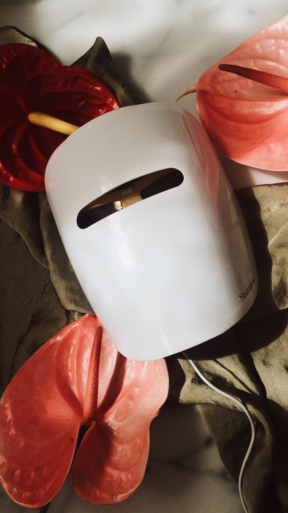 I SHOWED YOU THIS BEFORE IN ONE OF OUR FIRST WOWS. THE   LIGHT THERAPY   MASK STILL WOWS ME, SO HERE WE GO AGAIN: IT'S A MASK THAT USES RED AND BLUE LIGHT TO COMBAT BACTERIA ON YOUR SKIN THAT LEAD TO ACNE OR BLEMISHES. USE IT 10 MINUTES A DAY (I DO IT BEFORE I GO TO BED), DURING WHICH YOU LOOK LIKE MICHEAL MYERS, SCARE AWAY YOUR PARTNER, YOUR CAT AND ANYONE WHO FACE TIMES YOU BUT IT'S WORTH IT! -T