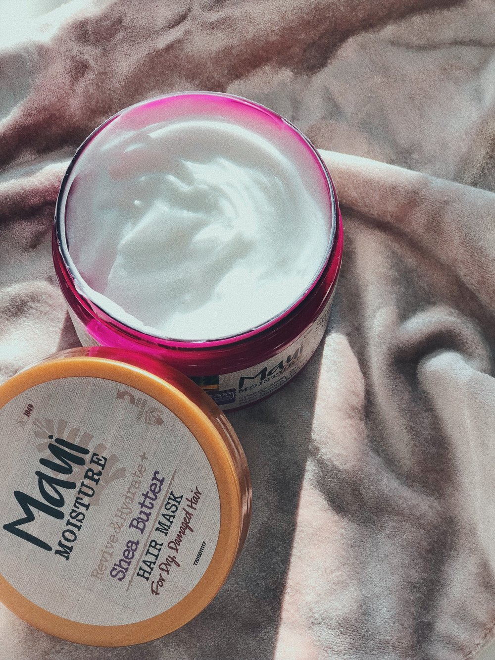 I DO A HAIR MASK EVERY TIME I WASH MY HAIR, WHICH IS ONCE A WEEK. IF I DON'T USE MY AVEDA OR MY BUDGET IS TIGHT, I LIKE TO USE THE   SHEA BUTTER ONE BY MAUI MOISTURE  , IT SMELLS GREAT AND IS REALLY HYDRATING. MY FAVORITE BUDGET ALTERNATIVE! – J