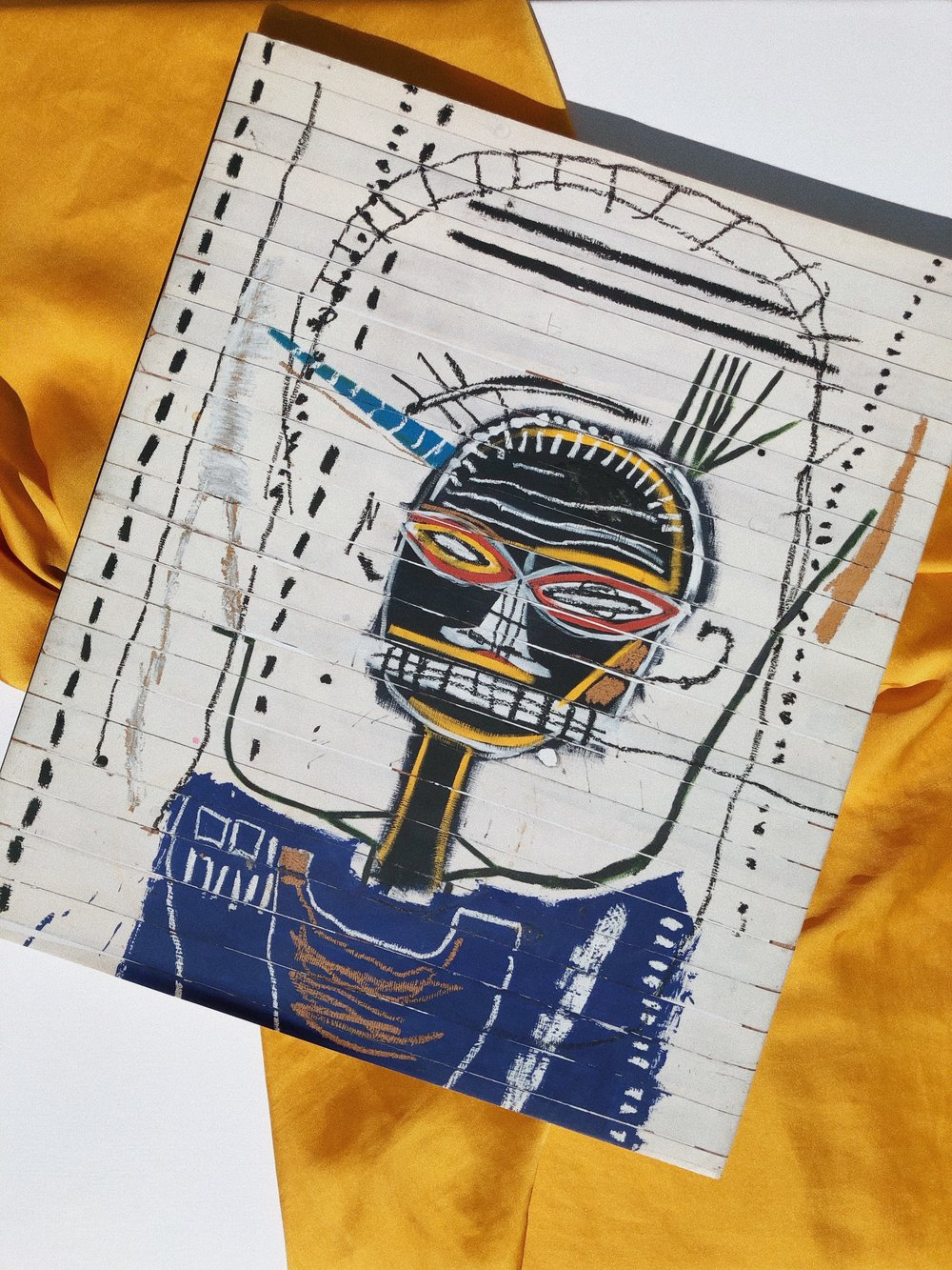 I WOULD NEVER CALL MYSELF AN ART CONAISSEUR, BUT IF I KNOW ONE ARTIST, IT'S JEAN-MICHEL BASQUIAT. I ABSOLUTELY ADORE HIM - AND   THIS BOOK   ABOUT HIM. IT'S PRICY BUT WORTH IT AND IT STANDS OUT BEAUTIFULLY IN MY APARTMENT.-J