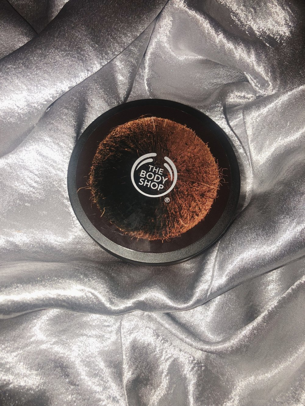 WHAT CAN I SAY? THE   BODY SHOP COCONUT BODY BUTTER   IS A STAPLE FOR ME. I LOVE HOW HYDRATED MY SKIN FEELS AFTER APPLYING THIS AND I LOVE THAT YOU DON'T HAVE TO RUB IT IN, IT LITERALLY JUST MELTS. AND IT HAS YOU SMELLING LIKE A DELICIOUS COCONUT. - J