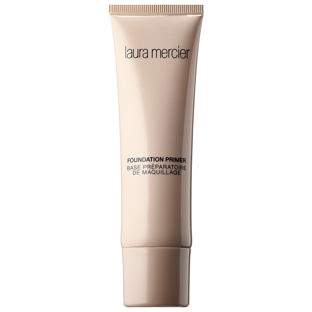 "LAURA MERCIER FOUNDATOIN PRIMER - What it is:A lightweight, creamy gel that creates an invisible barrier between skin and makeup to prime your face for color. What it does:Worn under foundation, this hydrating primer creates a smooth, flawless canvas for application, allowing foundation to glide on easily and stay fresh, keeping color true for hours. Ideal for drier skins, this hydrating formula nourishes with moisture-rich vitamins to soothe and condition. It's the first step to Laura's ""Flawless Face."" Dermatologist-tested and non-comedogenic, it contains antioxidants vitamins A, C, and E and hydrating properties thanks to glycerin and hyaluronic acid."