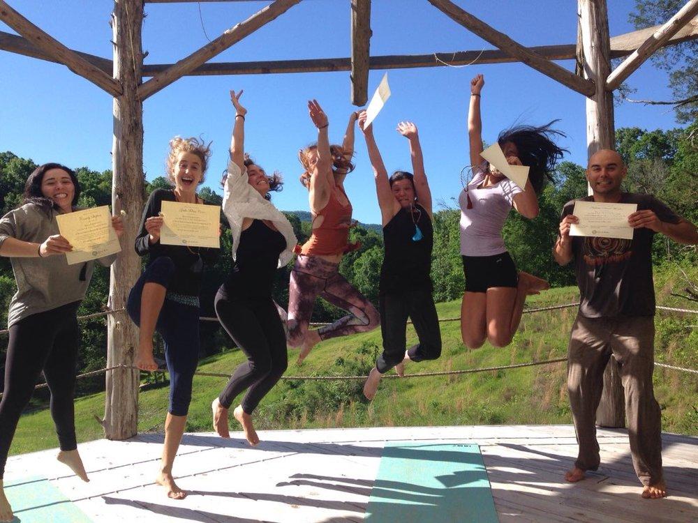 April YTT Graduates jumping.jpg