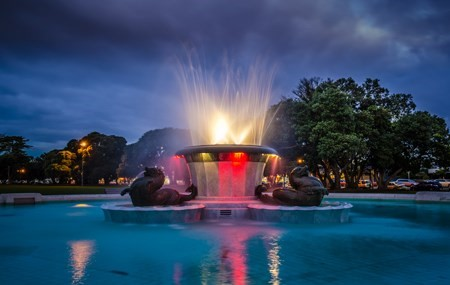 Fountain-water-feature-light-clouds-sky-trees
