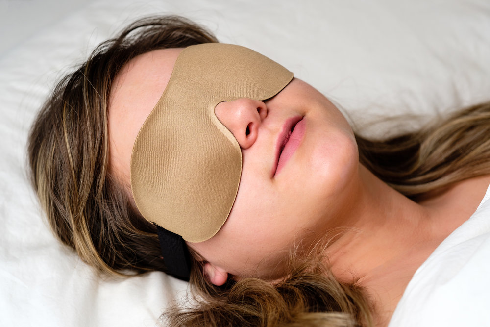 Resting wearing a sleep mask