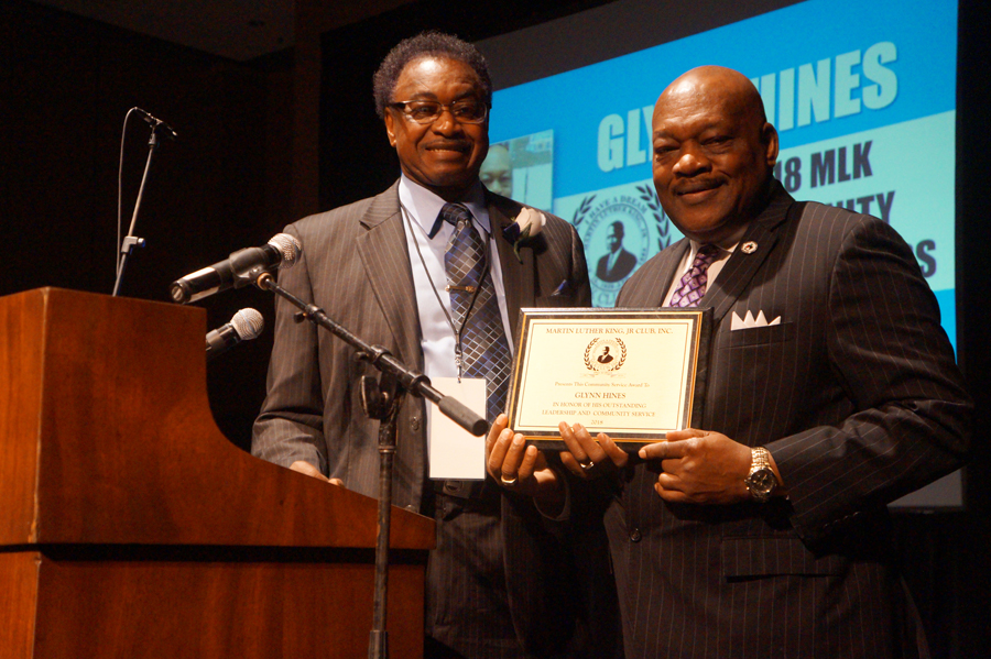 Glynn Hines receiving the 2018 MLK Club Community Service Award from MLK Club President Bennie Edwards.