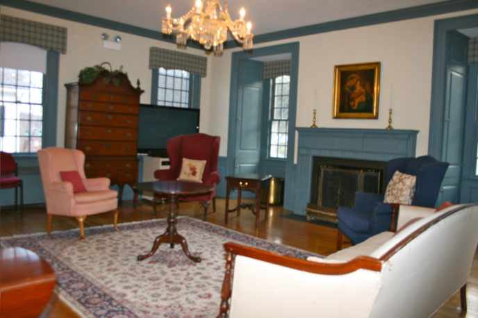 The Colonial Room  - The historically decorated Colonial Room with its living-room style furniture and working fireplace provides an inviting environment conducive to discernment and discussion