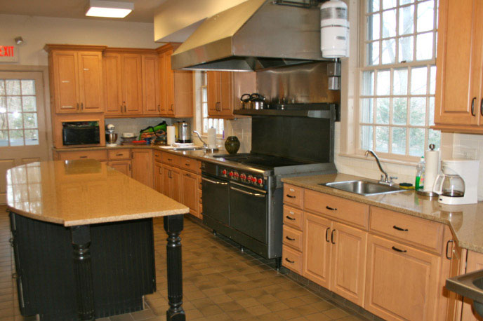 Caterer's Kitchen - Pilgrim Hall connects with a fully functioning caterer's kitchen featuring professional-grade appliances, a large center island and granite countertops.