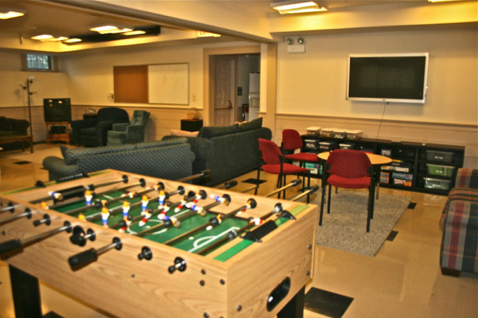The Youth Room  - The church's Youth Room encourages camaraderie and fun, boasting relaxed, comfortable furnishings, foosball and air hockey tables, a refrigerator and projector with 12-foot projection screen.